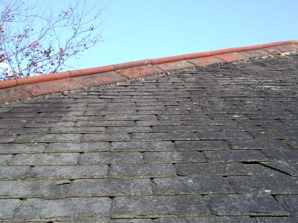 Roof Renovation of Hip and Ridge Tiles Before Photo - Bournemouth Roofing Dorset